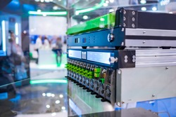 Upstream dual receiver, optical amplifier, codec module - telecommunications equipment at broadcasting exhibition, trade show - close up