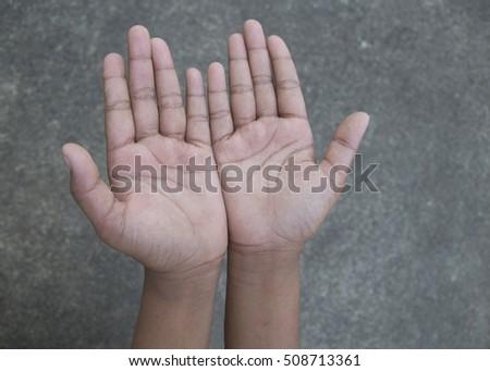 Upturned hands on sidewalk background #508713361