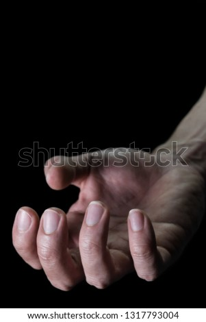 Upturned Human Hand for Devil Crime Violence Concept in Book Cover Style. Upturned Human Hand Portrait View for Devil Crime Violence Concept