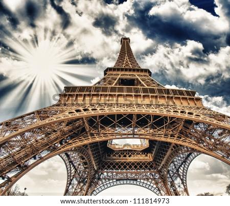 Upward Fisheye view of Eiffel Tower in Paris on a sunny winter morning - France