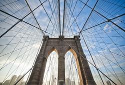 Upward image of Brooklyn Bridge in New York