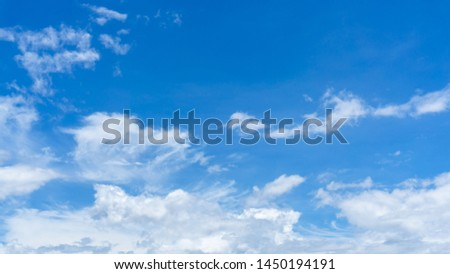 Upward skyscape view from clear glass window seat on aircraft to cloudscape, traveling on white fluffy clouds and vivid blue sky in a suny day  #1450194191