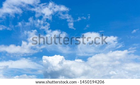 Upward skyscape view from clear glass window seat on aircraft to cloudscape, traveling on white fluffy clouds and vivid blue sky in a suny day  #1450194206