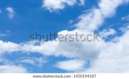 Upward skyscape view to cloudscape, shape of white fluffy clouds look like the eagles bird  flying on vivid blue sky in a suny day  #1450194107