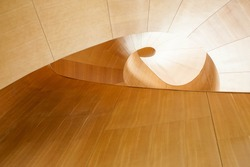 upward view of modern architectural design with spiraling wood panels