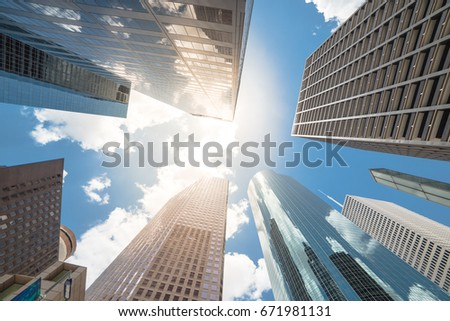 Upward view of skyscrapers against a cloud blue sky in the business district area of downtown Houston, Texas, US. #671981131
