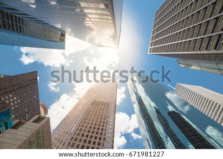 Upward view of skyscrapers against a cloud blue sky in the business district area of downtown Houston, Texas, US. #671981227