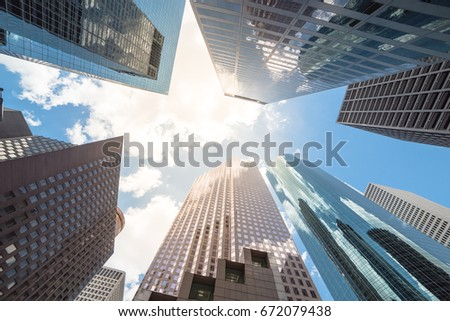 Upward view of skyscrapers against a cloud blue sky in the business district area of downtown Houston, Texas, US. #672079438