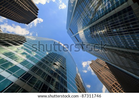Upward view of tall skyscrapers in downtown Chicago.