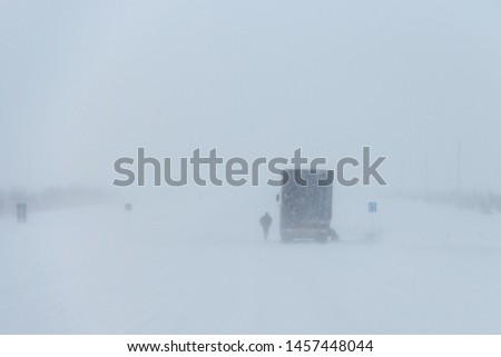 Uralsk, Taskala, ZKO, Kazakhstan - 22.02.2019: snow storm in winter, cars on the highway in winter, bad weather, visibility zero on the road #1457448044