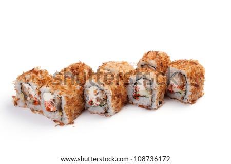 Uramaki. Golden Dragon. On a white background. Smoked eel, Philadelphia cheese, tobikko, cucumber, avocado, tuna flakes.