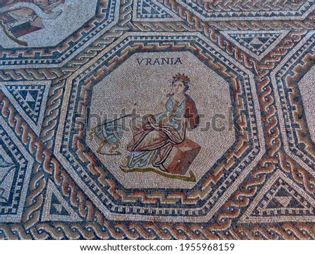 Urania - one of 9 muses portrayed in medalion with geometric ornamented borders. The Roman floor mosaic is freely accessible for everybody outdoors in Vitchen, Luxembourg Zdjęcia stock ©