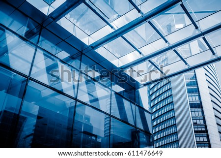 Urban abstract - windowed corner of office building  #611476649