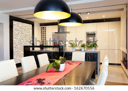Urban apartment - New kitchen with original stone wall