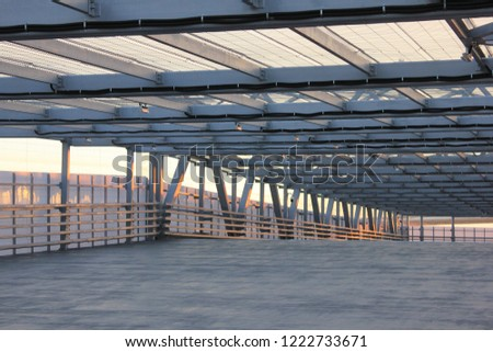 Urban Architecture Abstract Street Passage Outdoors. Modern Structure of Empty Bridge Road on Summer Day. Contemporary Urban City Building Interior with Cement Floor, Steel Walls and Open Air Roof #1222733671