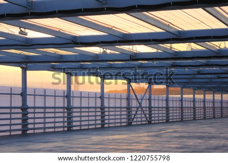 Urban Architecture Abstract Street Passageway Outdoors. Modern Structure of Empty Bridge Road on Evening Sunset Background. Contemporary Urban City Building Interior Passage with Metal Walls and Roof #1220755798