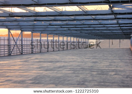 Urban Architecture Abstract Street Passageway Outdoors. Modern Structure of Empty Bridge Road on Evening Sunset Background. Contemporary Urban City Building Interior Passage with Metal Walls and Roof #1222725310