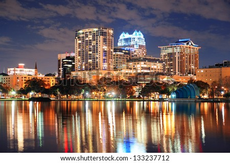 Urban architecture with Orlando downtown skyline over Lake Eola at dusk - stock photo