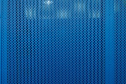 Urban background. Perforated metal sheet with rivets. Copy space