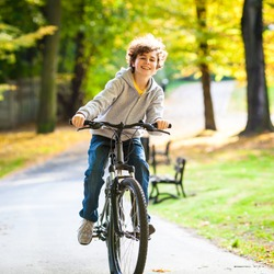 Urban biking - teenage boy and bike in city park