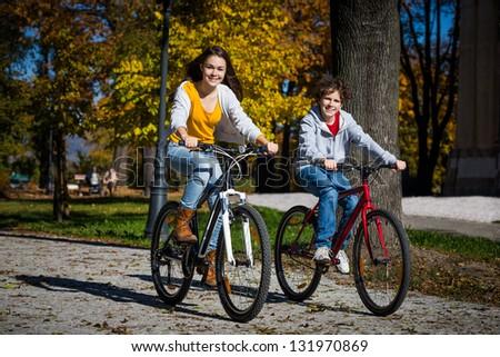 Urban biking - teens and bikes in city
