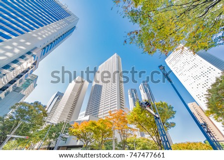 Urban buildings and trees #747477661