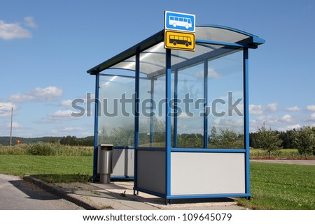 Urban bus stop shelter by street at summer in Salo, Finland.