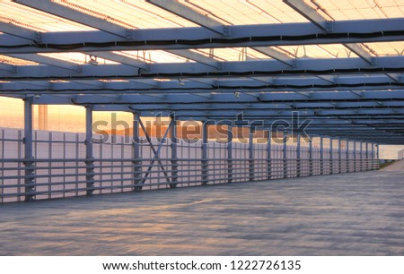 Urban City Architecture Abstract Street Passageway Outdoors. Modern Structure of Empty Bridge Road on Sunset Background. Contemporary Modern City Building Interior Passage with Metal Walls and Roof #1222726135