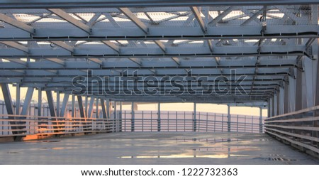 Urban City Architecture Abstract Street Passageway Outdoors. Modern Structure of Empty Bridge Road on Sunset Background. Contemporary Modern City Building Interior Passage with Metal Walls and Roof #1222732363