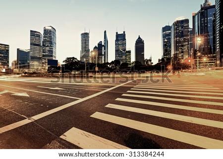 Urban city at night with traffic and night skyline #313384244