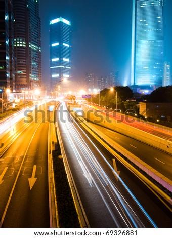 Urban city at night with traffic and night skyline, shanghai China.