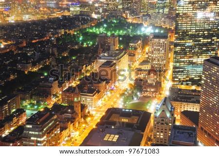 Urban city night scene. Boston aerial view with skyscrapers at night with city skyline illuminated.