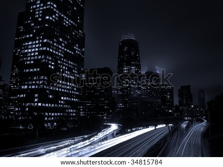 Urban City Traffic and Skyline at Night