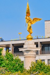 Urban cityscape of Washington. Gold winged Victory statue in World War I Memorial.