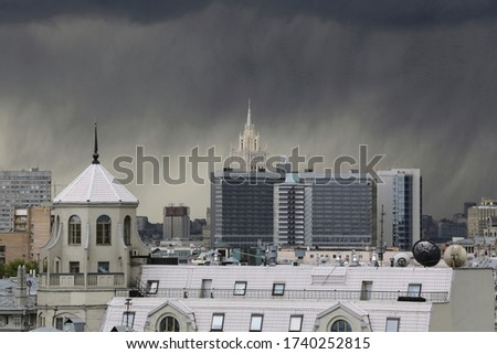 urban cityscape panorama day view of buildings, monuments, roofs, rooftops on a dark stormy sky and black rain clouds background. Moscow, Russia  Stock photo ©