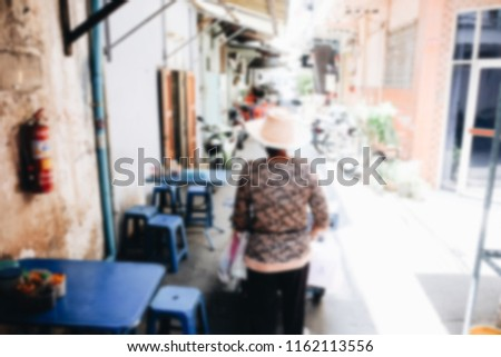 Urban defocused background of the Chinese block courtyard in Bangkok. Vintage filter blur background