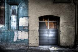 Urban doors. Wood and stone textures