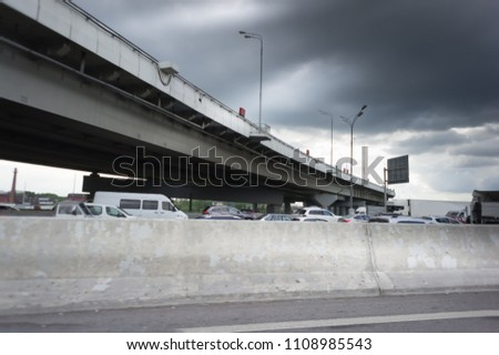 Urban Elevated Roads with concrete blocks on both sides. Black clouds on the sky. Storm is coming #1108985543