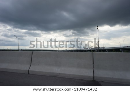 Urban Elevated Roads with concrete blocks on both sides. Black clouds on the sky. Storm is coming #1109471432