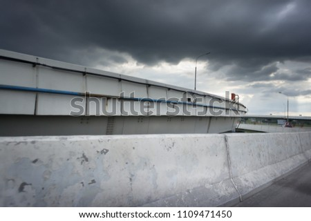 Urban Elevated Roads with concrete blocks on both sides. Black clouds on the sky. Storm is coming #1109471450