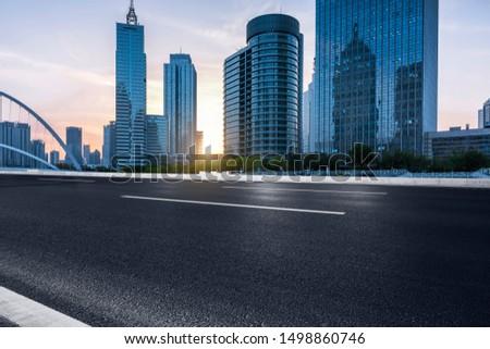 Urban expressways pass through modern city skyscrapers.
