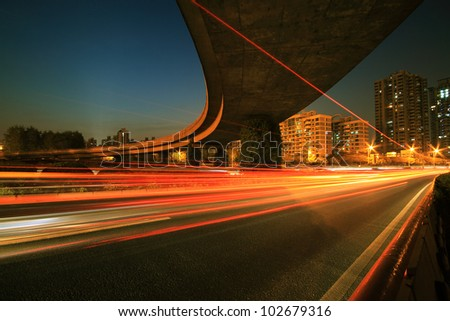 Urban focus of a major cities ring highway viaduct with light trails night Scene