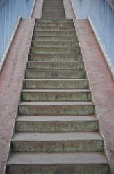 Urban footbridge staircase with symmetrical composition