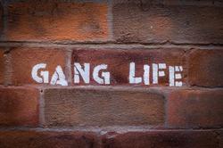 Urban Gang Life Stencil Graffiti On A Red Brick Wall