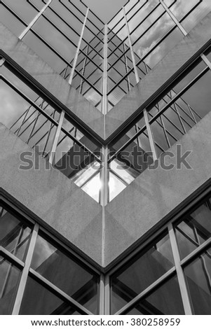 Urban Geometry, looking up to building. Modern architecture black and white, concrete and glass.  Abstract architectural design. Inspirational, artistic image BW. Artistic image and point of view. #380258959