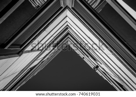 Urban Geometry, looking up to building. Modern architecture black and white, concrete and glass.  Abstract architectural design. Inspirational. Artistic image and point of view. #740619031