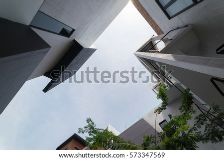 Urban Geometry, looking up to cement building. Modern and abstract architecture design .