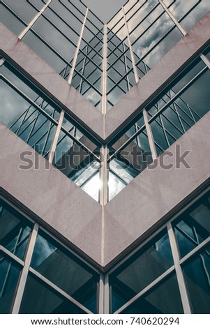 Urban Geometry, looking up to glass concrete building. Modern architecture black and white, glass and concrete building. Abstract architectural design. Inspirational, artistic image.