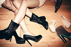 urban girls with their shoes indoor shot