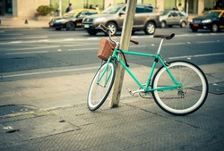 Urban green Bicycle parked in the street